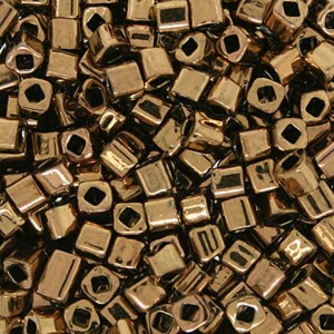 Toho® Χάντρα Cube (Κύβος) 3mm - 221 Metallic Bronze ~10gr